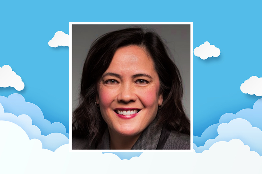 Head shot of Karen Bryant overlaying a background graphic of clouds and blue sky